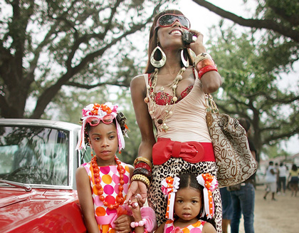 Angel Price and her daughters attend the first post-Hurricane Katrina parade at the Big 7 Social and Pleasure Club