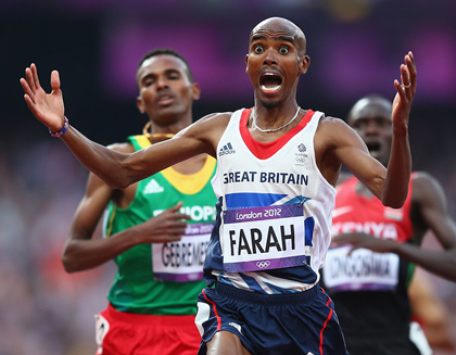 Mohamed Farah celebrates as he wins gold in the Men's 5000m final in the London 2012 Olympics