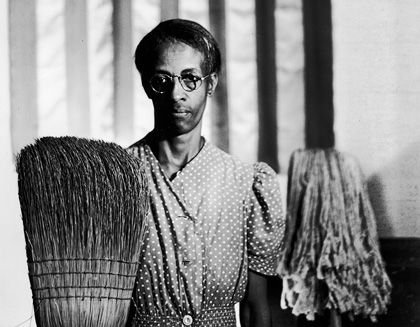 "Ella Watson, an African American cleaning woman, poses to imitate Grant Wood's ""American Gothic"""