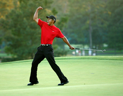 Tiger Woods celebrates after sinking a putt on the first playoff hole to win the 2005 Masters